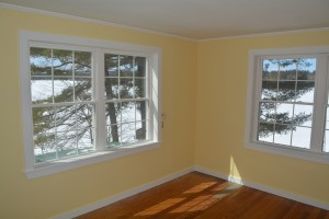 After - the bedroom area of the new Winter Harbor Suite overlooking snow and ice covered Tripp Lake..