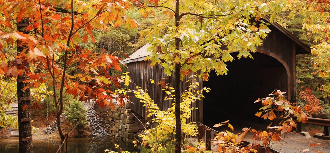 Covered bridge surrounded by fall foliage