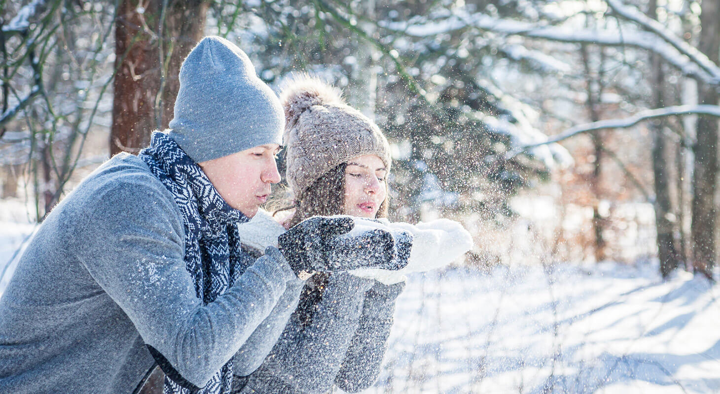Couple playing with snow in the winter