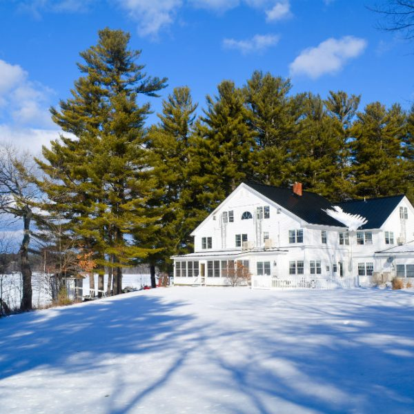 Exterior of the our Maine B&B covered in snow