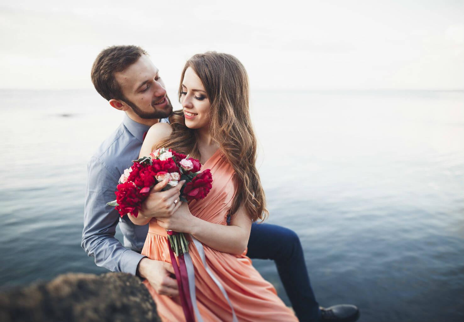 Couple enjoying bouquet by lake
