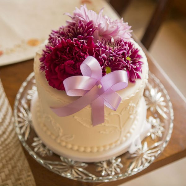 Small wedding cake covered in flowers