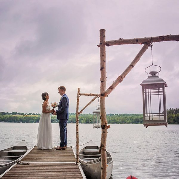 Bride and groom exchange vows on the docks in the summer
