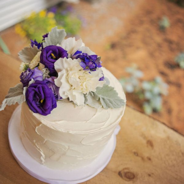 Small wedding cake on table outside