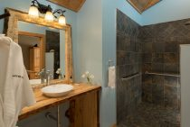 Granite shower and wooden sink in cabin bathroom