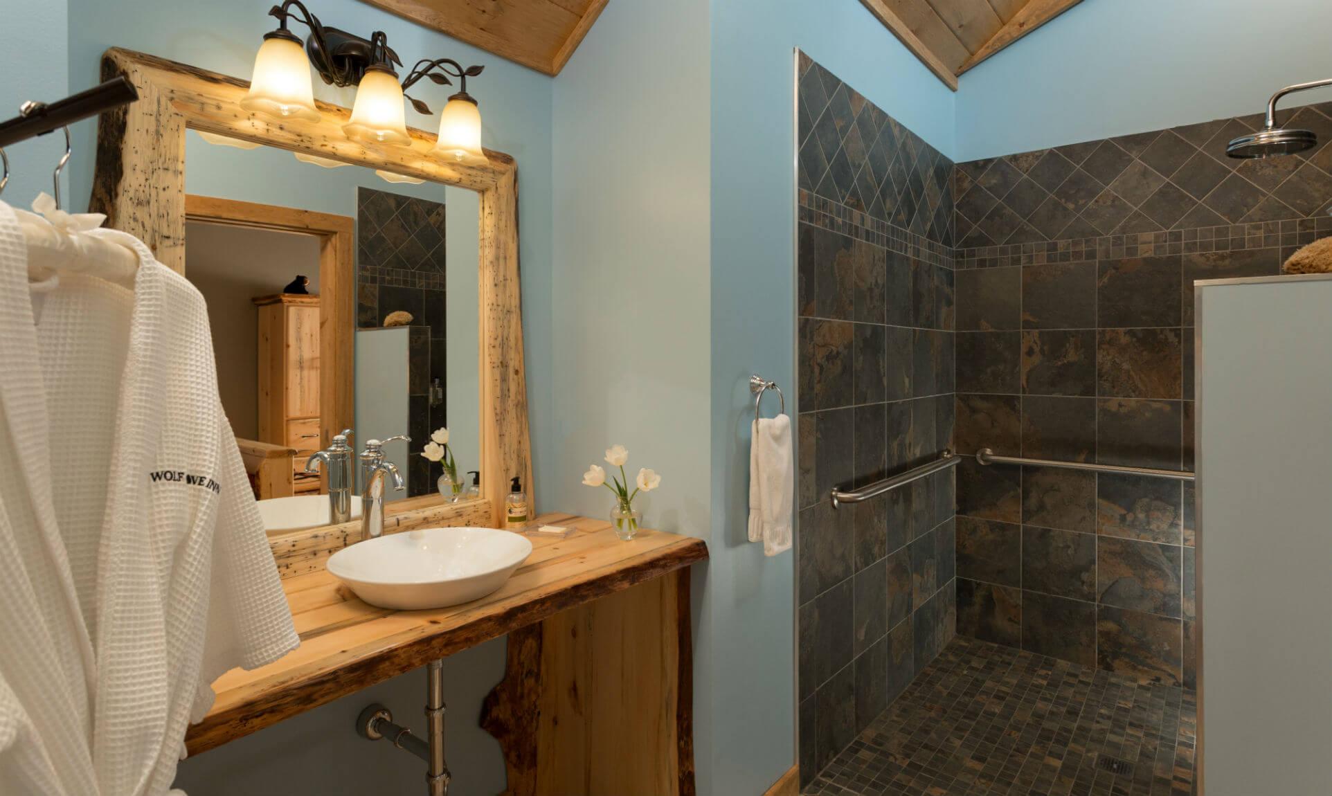 Granite shower and wooden sink in cabin bathroom