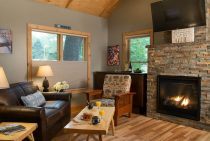 Sitting area with coffee by brick fireplace and television