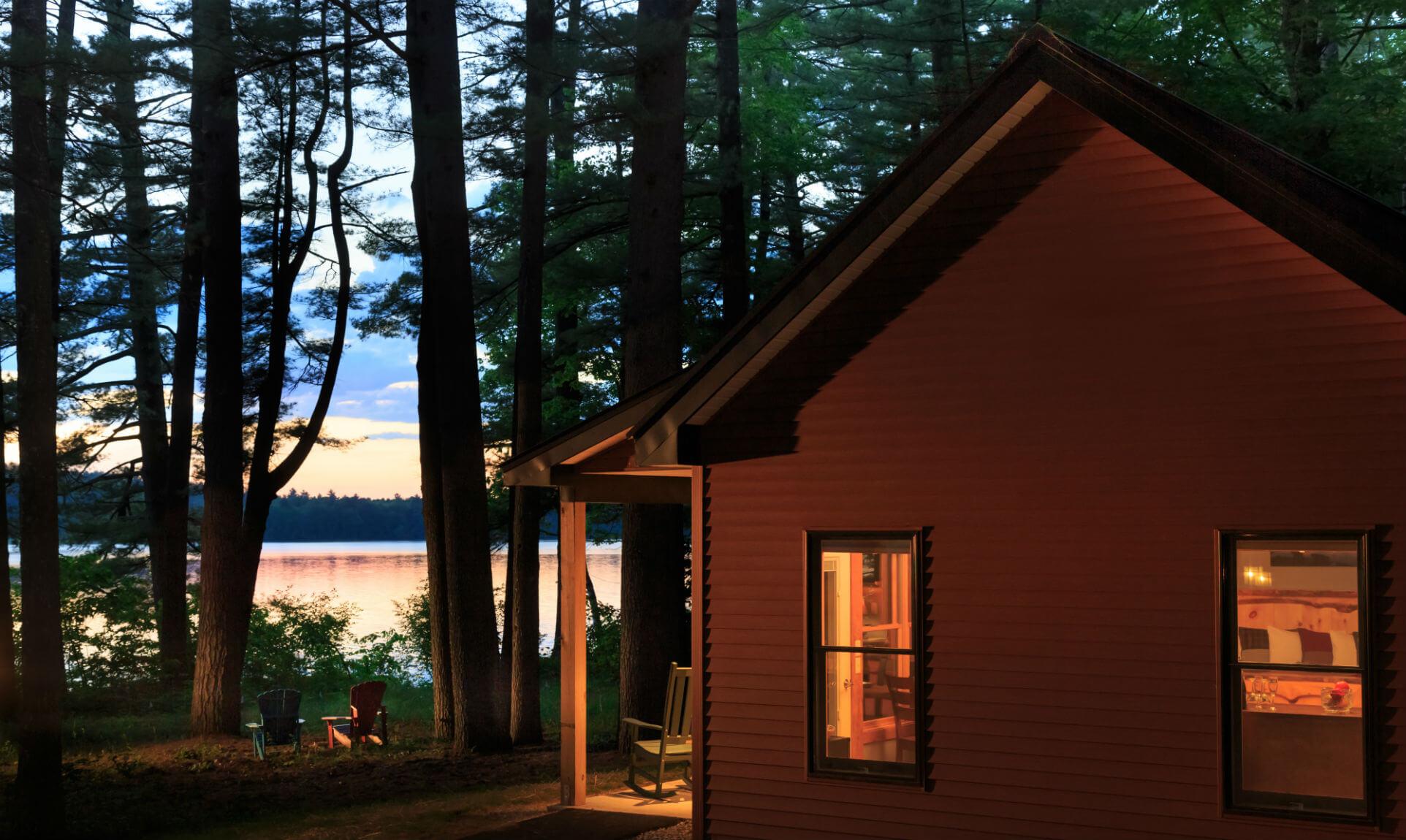 Exterior of Eagle's Nest Cabin nestled in trees near lake