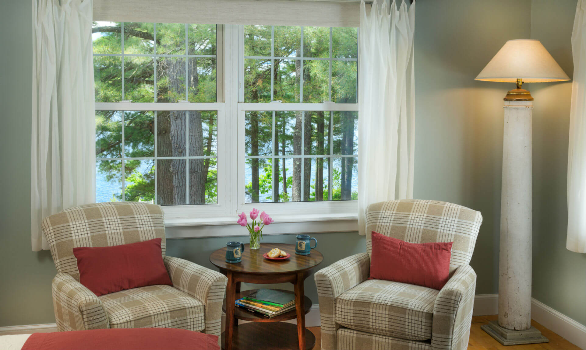 Sitting area with plush chairs next to window in the Wolf Cove Inn's Moosehead Lake room