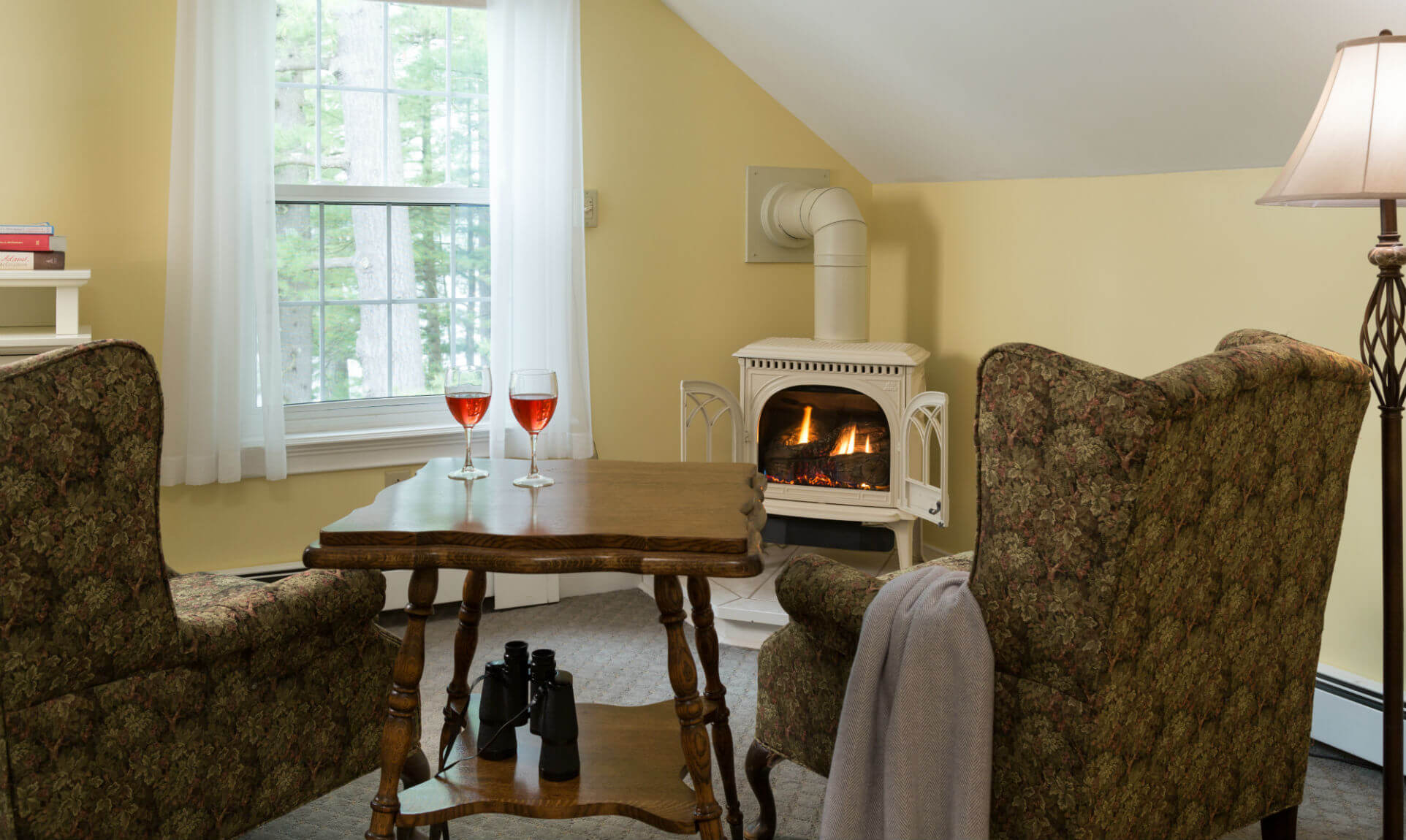 Sitting area with wine and gas fireplace in the Mount Katahdin room