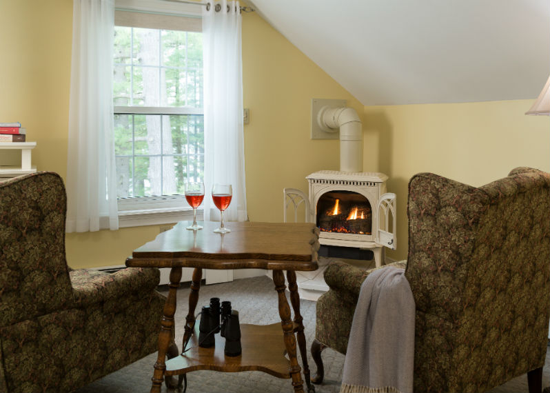 Sitting area with wine and fireplace in the Mount Katahdin room