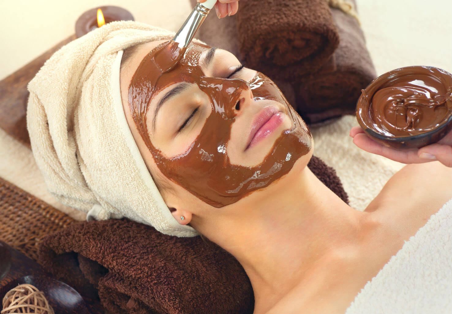 Woman receiving chocolate facemask