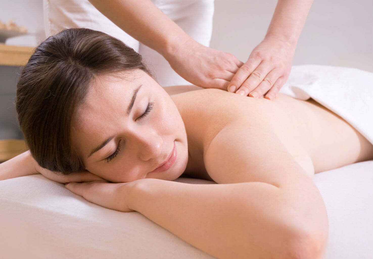 Woman receives therapy massage