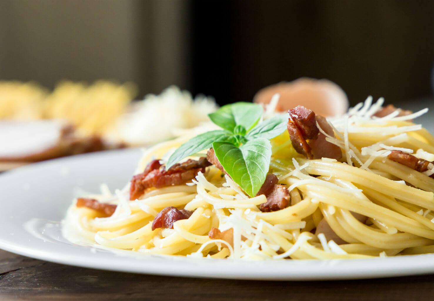 Spaghetti dinner with bacon, herbs, and cheese