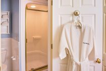 Closer view of shower and bathrobe