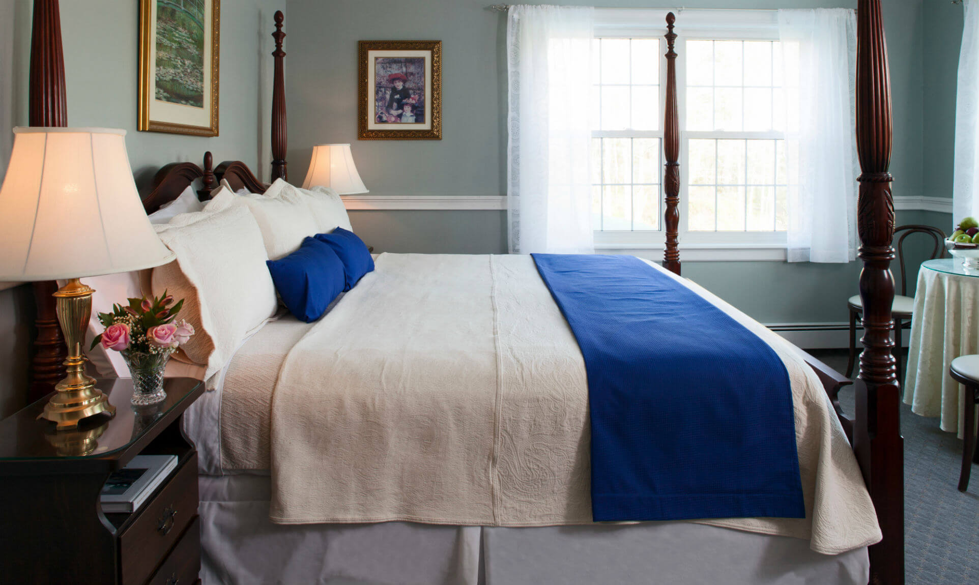 Soft antique bed with white sheets and pillows and blue accents