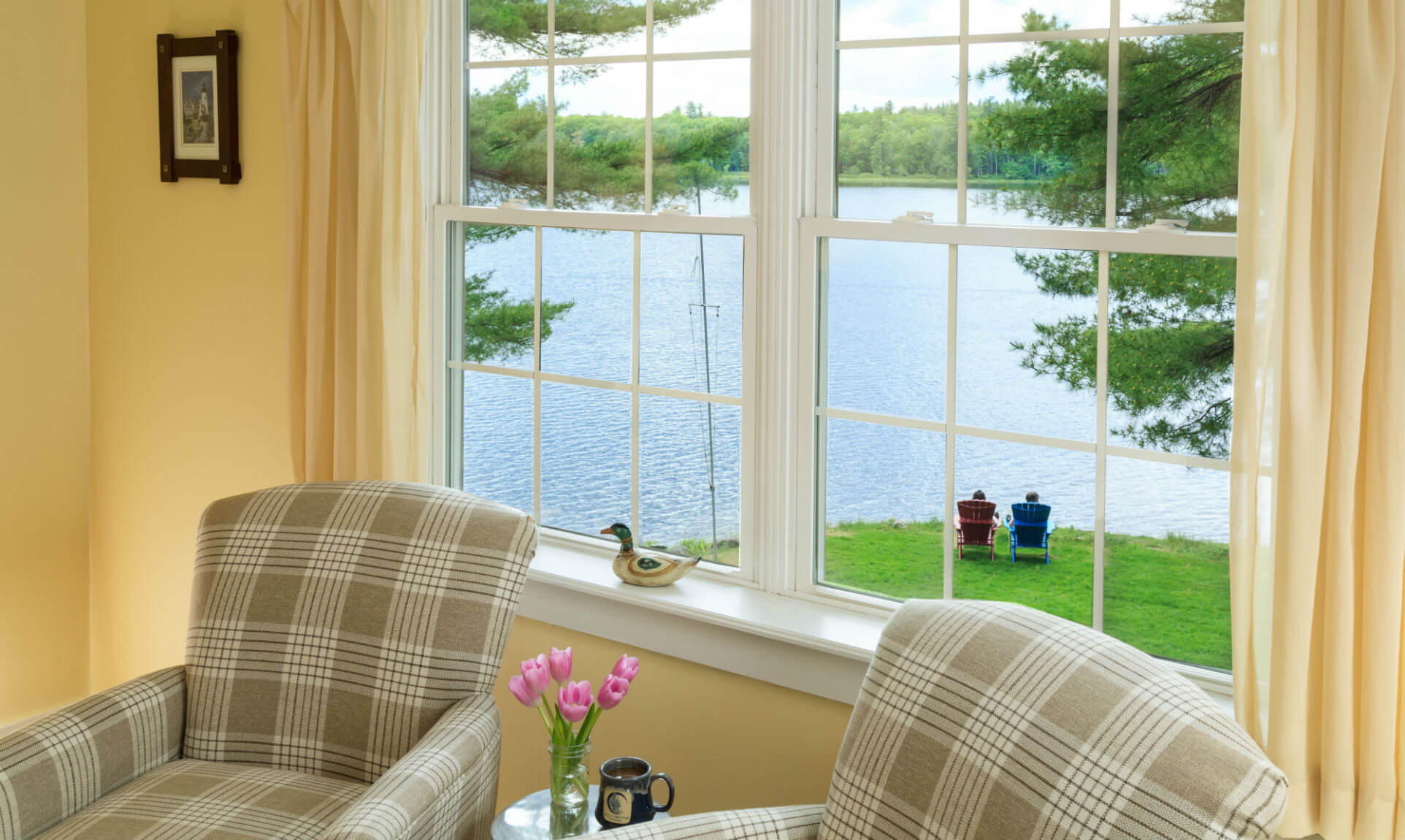 Sitting area and window overlooking lake seating area