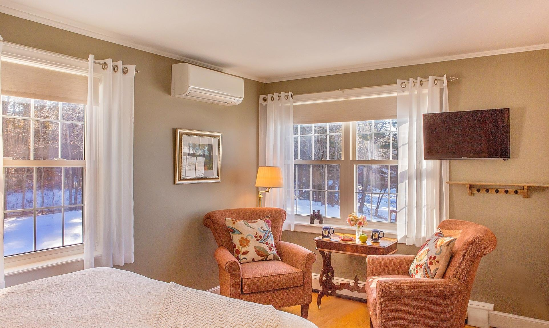Seating area with two chairs in Sebago Lake room