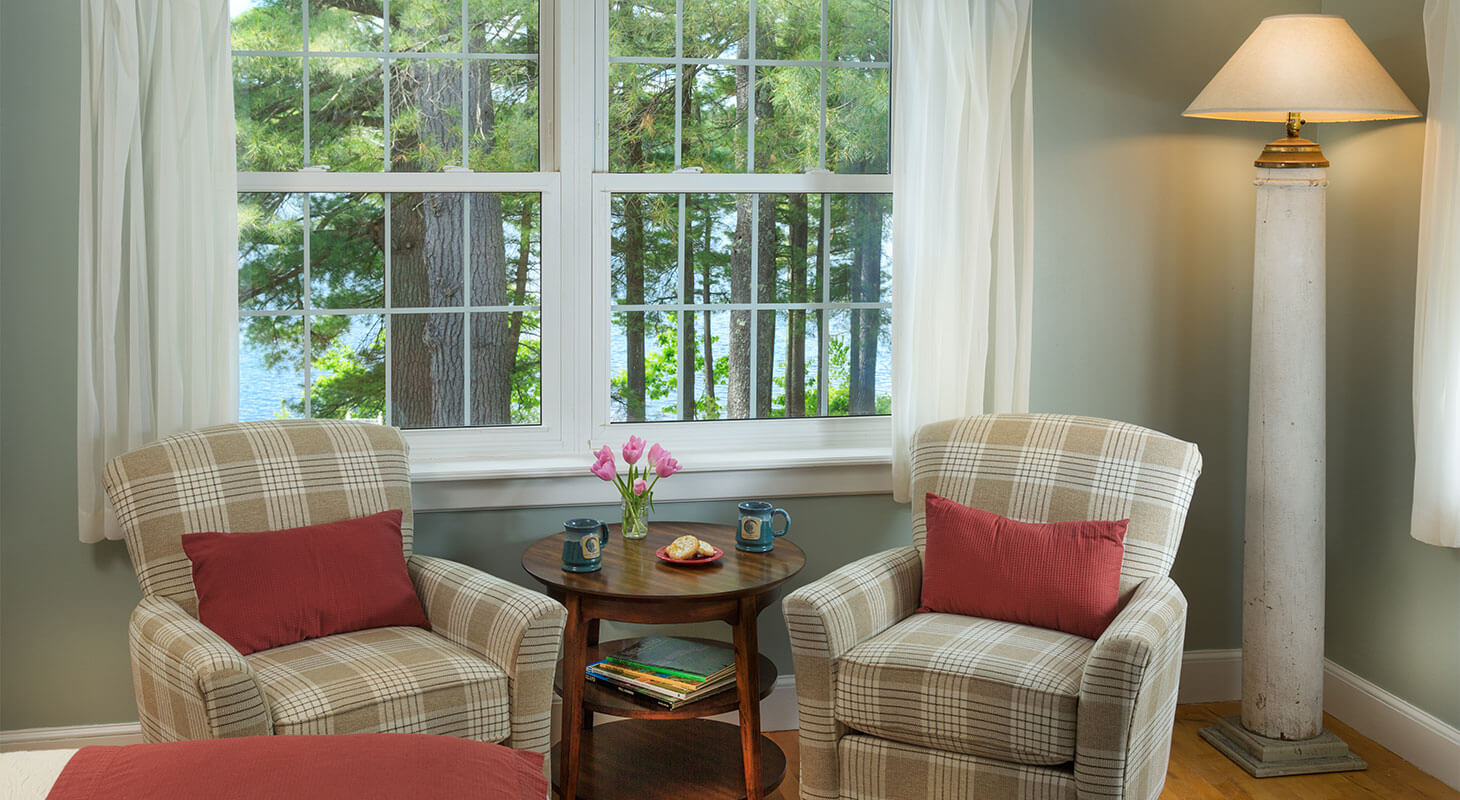 Plaid chairs in Moosehead Lake Room next to big window