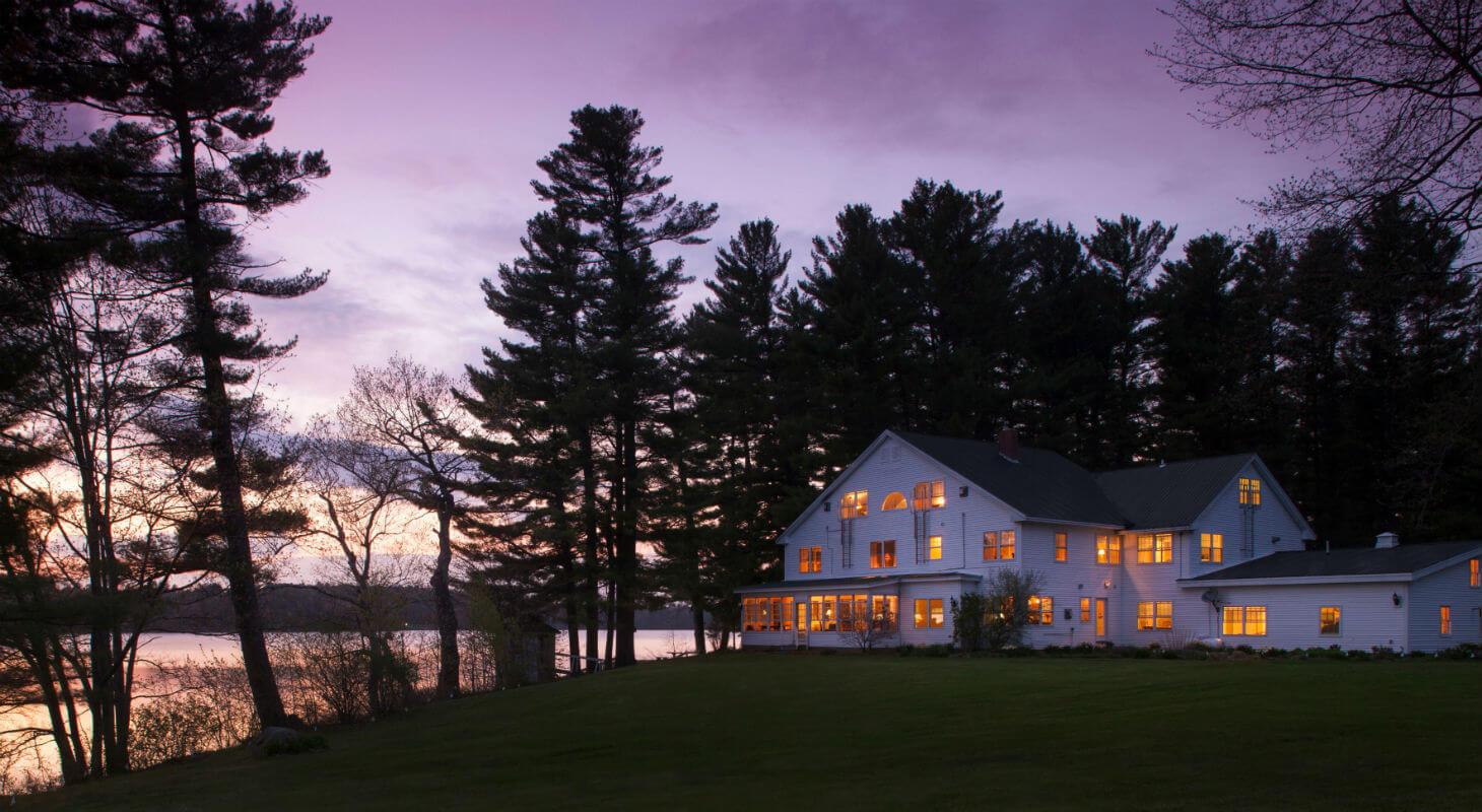 Springtime twilight image of illuminated lakeside Inn