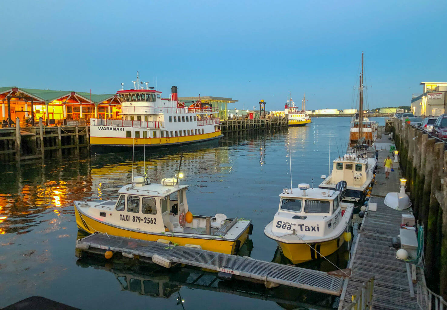 Boats by docks on the waterfront of Portland, Maine