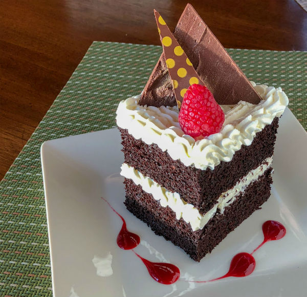 Double-layered artisan chocolate cake dessert in the Boathouse Bistro
