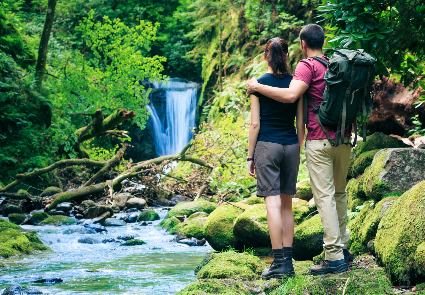 Couple goes for riverside hike together
