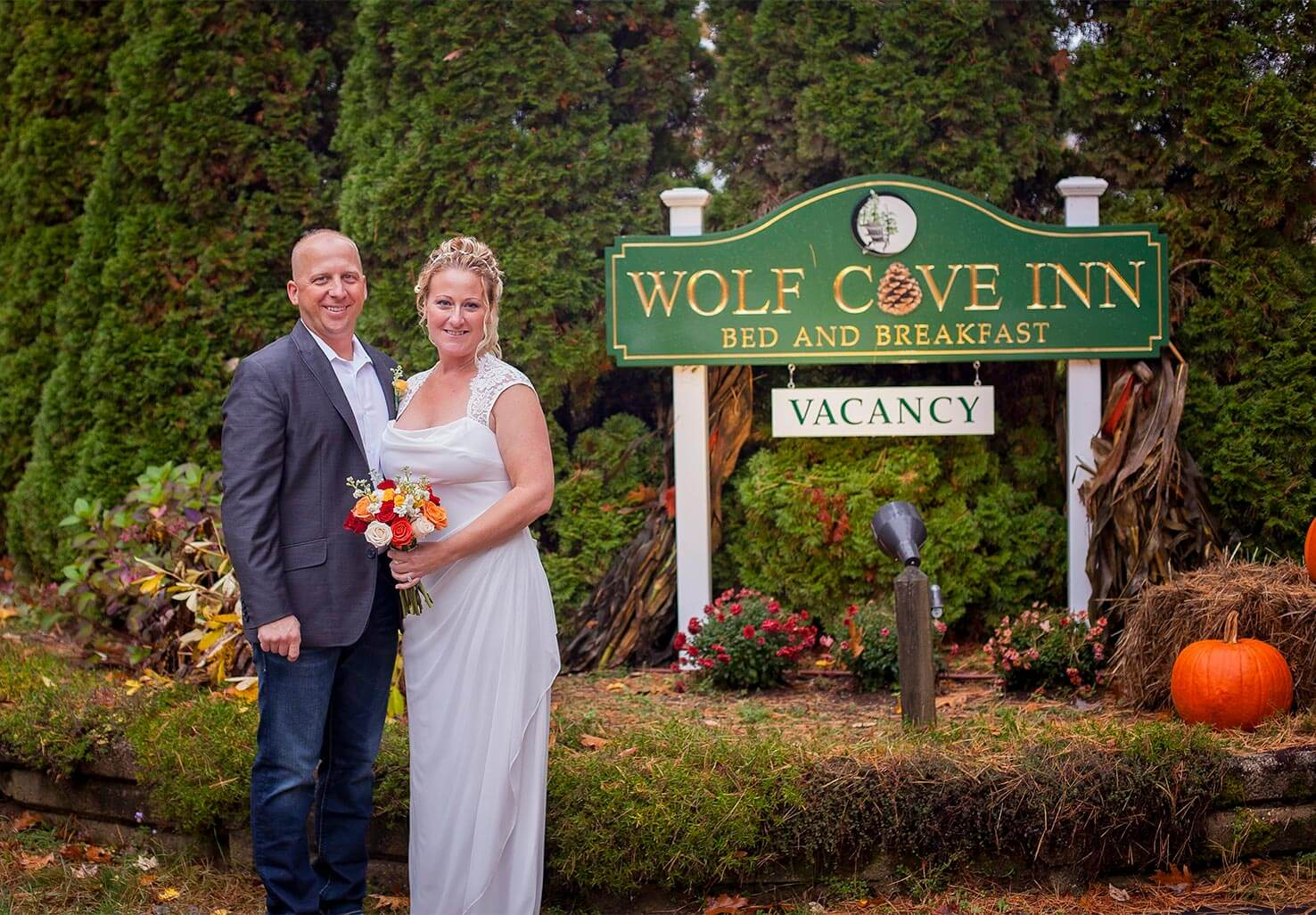 Elopement couple in front of Wolf Cove Inn sign