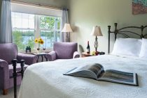 Cadillac Mountain room at Wolf Cove Inn with view of bed and Tripp Lake