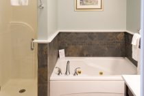 Jetted spa tub next to walk in shower