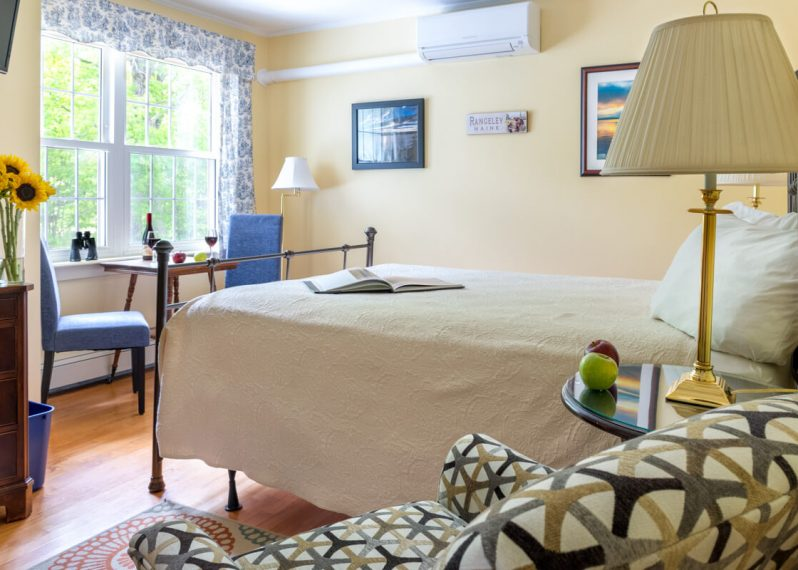 Rangeley Lake room bed and view at Wolf Cove Inn
