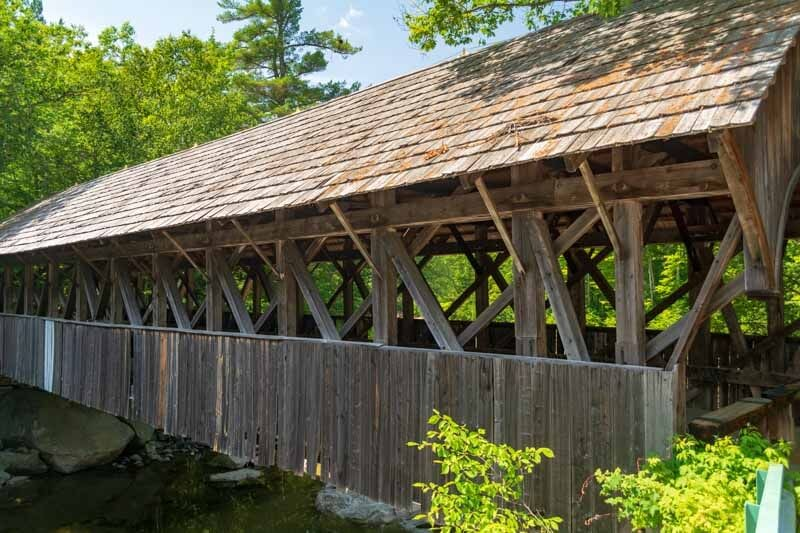 wooden covered bridge over river