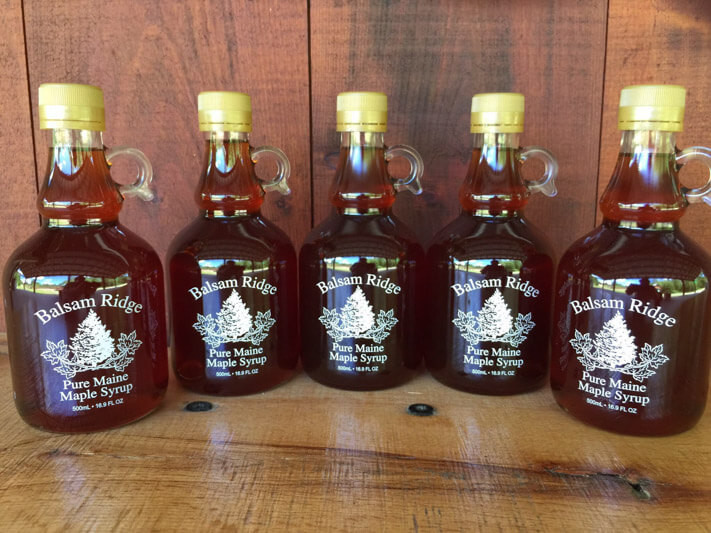 5 glass jugs of pure golden brown maple syrup