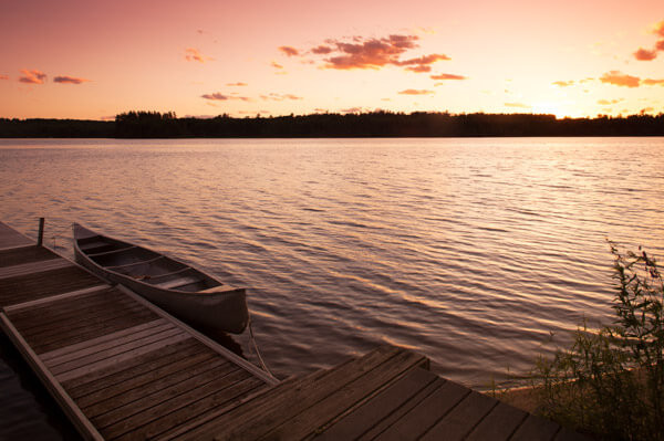 Canoe At Sunset On Tripp Lake
