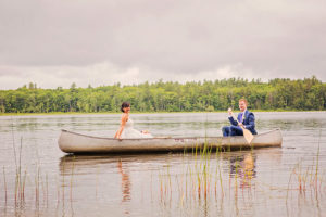Elope in Southern Maine - Couple on Lake in Boat