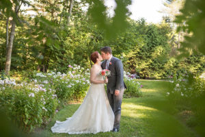 Elopement couple kissing in the gardens in Maine