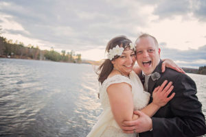 Happy elopement couple on the dock at Tripp Lake in Southern Maine