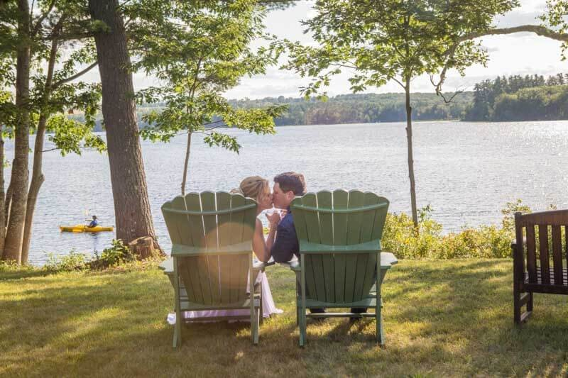 Couple Kissing Lakeside After Intimate Maine Wedding Reception