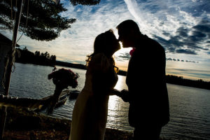 Sunset kiss at a lakeside elopement