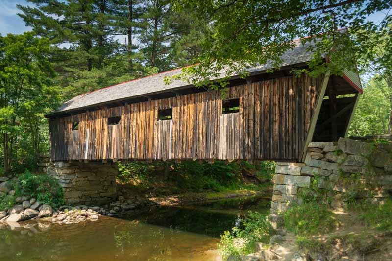 Visit Lovejoy Covered Bridge in the Autumn in Maine