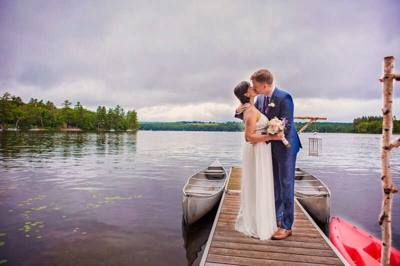 Wedding Couple Kissing On Dock