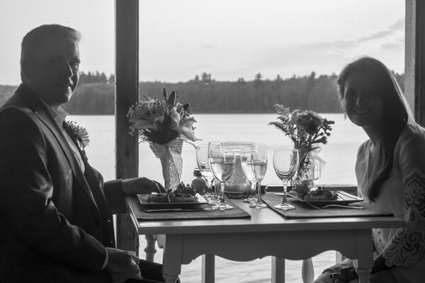 Black and white shot of a couple having romantic dinner