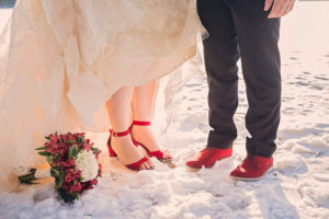 Winter elopement in Maine with red shoes in the snow