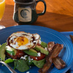 A breakfast of Eggs On Roasted Tomatoes