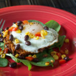 Eggs Over Sweet Potato Hash Brown And Baby Spinach With Southwest Salsa
