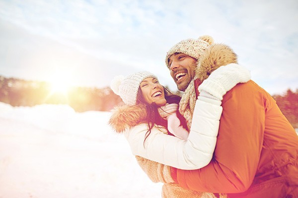 Couple in the snow laughing